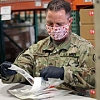 Washington National Guard members build COVID-19 test kits